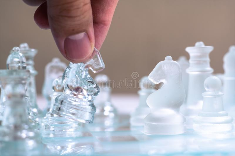 Chess game. A knight is moving forward to take the advantage of the game. Business competitive concept. Achievement adrenaline ahead ambition brave challenge stock photos
