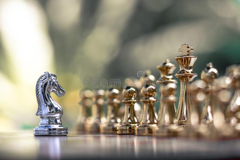 Chess game. A knight stand determinedly among the enemies. Business competitive concept. Achievement adrenaline ahead ambition brave challenge champion chance royalty free stock photo
