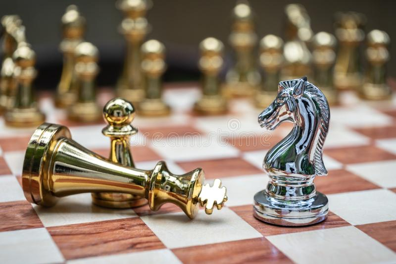 Chess game. Knight stand over the fallen king. Business winner concept. Achievement adrenaline ahead ambition brave challenge champion chance competition stock image