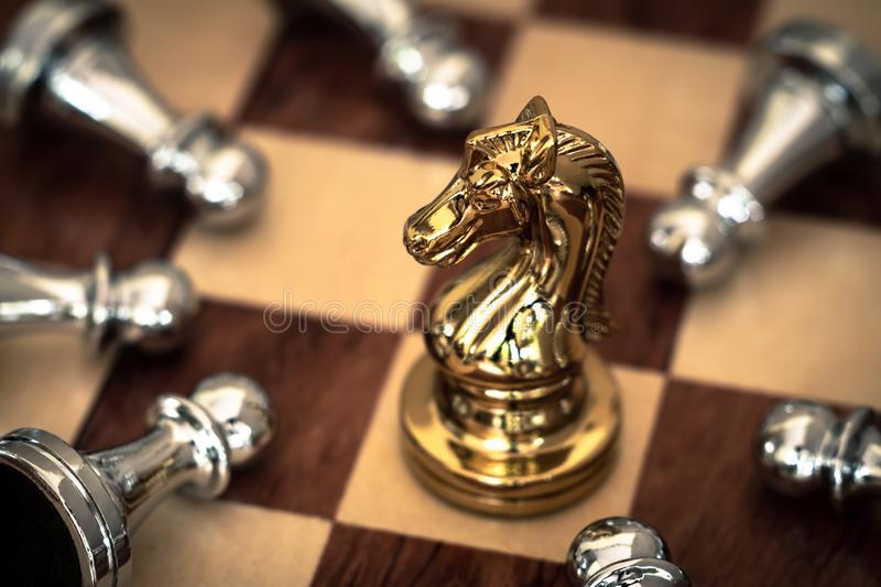 Chess game. A knight takes downs all enemies. Business competitive concept stock images