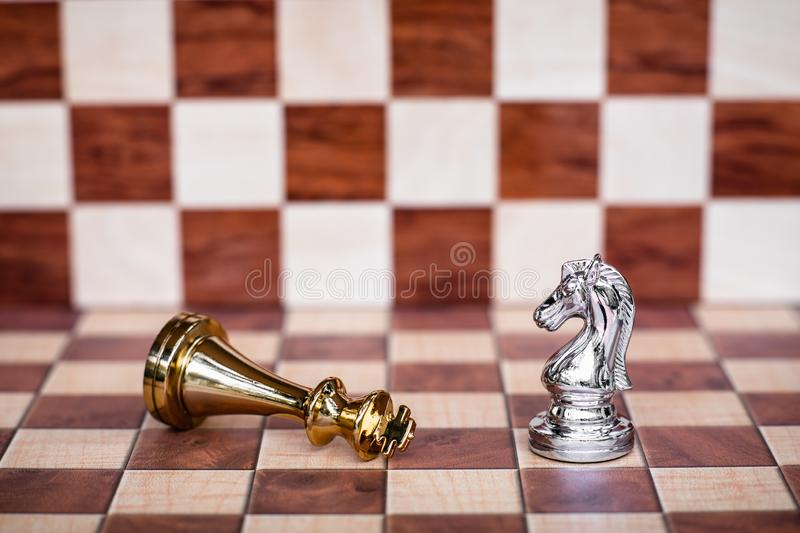 Chess game. A knight takes downs all enemies. Business competitive concept. Achievement, adrenaline, ahead, ambition, brave, challenge, champion, chance stock image