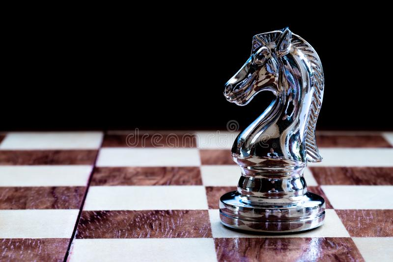 Chess game. A knight waiting for the right time to move. Business strategy and competitive concept. Copy space achievement adrenaline ahead ambition brave stock photos