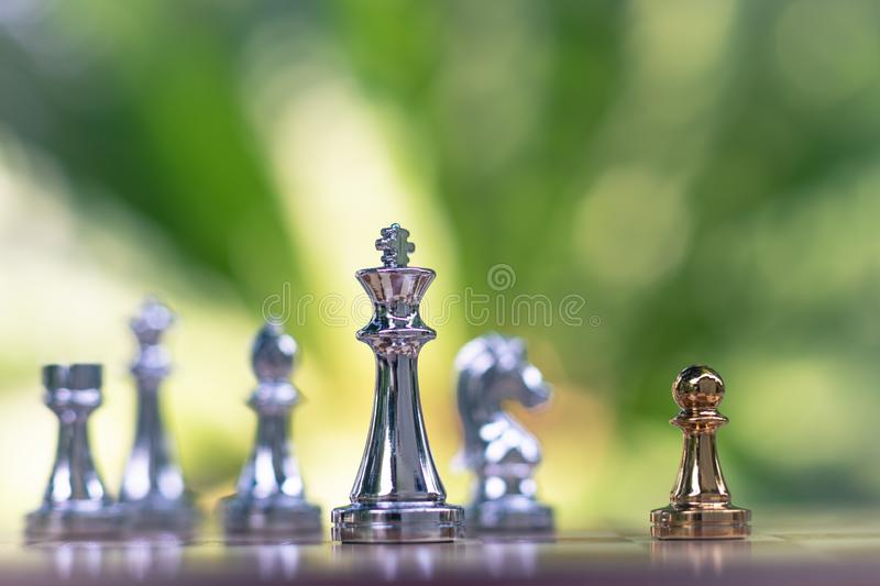 Chess game. Little pawn challenges the powerful king. Business strategy and competitive concept royalty free stock photos