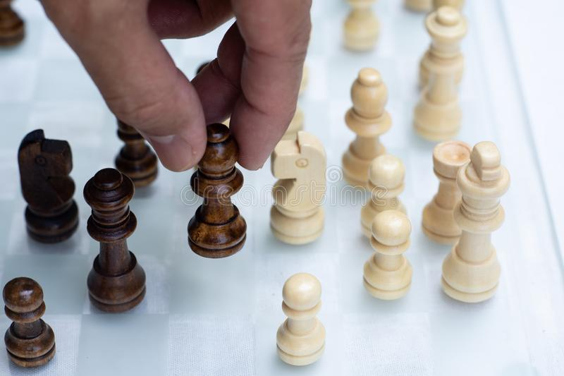 Chess game. A move to kill. Refer to business strategy and competitive concept. Achievement adrenaline ahead ambition brave challenge champion chance stock photos