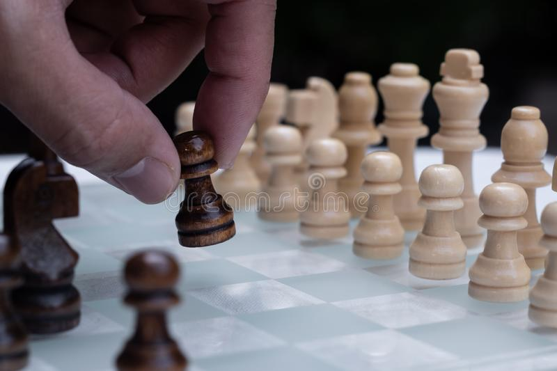 Chess game. A move to kill. Refer to business strategy and competitive concept. Achievement adrenaline ahead ambition brave challenge champion chance royalty free stock images