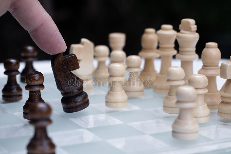 Chess game. A move to kill. Refer to business strategy and competitive concept. Achievement, adrenaline, ahead, ambition, brave, challenge, champion, chance royalty free stock photos