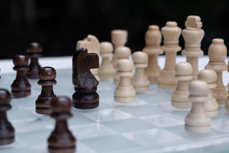 Chess game. A move to kill. Refer to business strategy and competitive concept. Achievement, adrenaline, ahead, ambition, brave, challenge, champion, chance royalty free stock photo