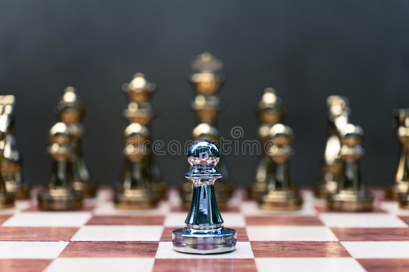 Chess game. Pawn stand determinedly against the enemies. Business competitive concept. Achievement adrenaline ahead ambition brave challenge champion chance royalty free stock photography
