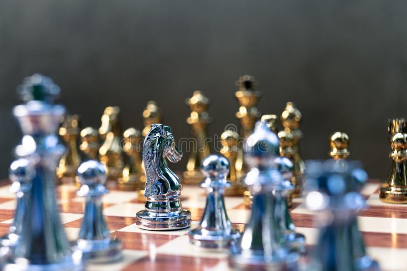 Chess game. Pawn stand determinedly against the enemies. Business competitive concept. A knight stand determinedly, promptly flight to the enemies. Business royalty free stock image