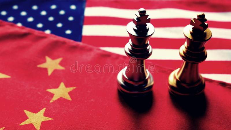 Chess game. Two kings face to face on Chinese and American national flags. Trade war and conflict between two big countries. USA. And China relationship concept royalty free stock photo