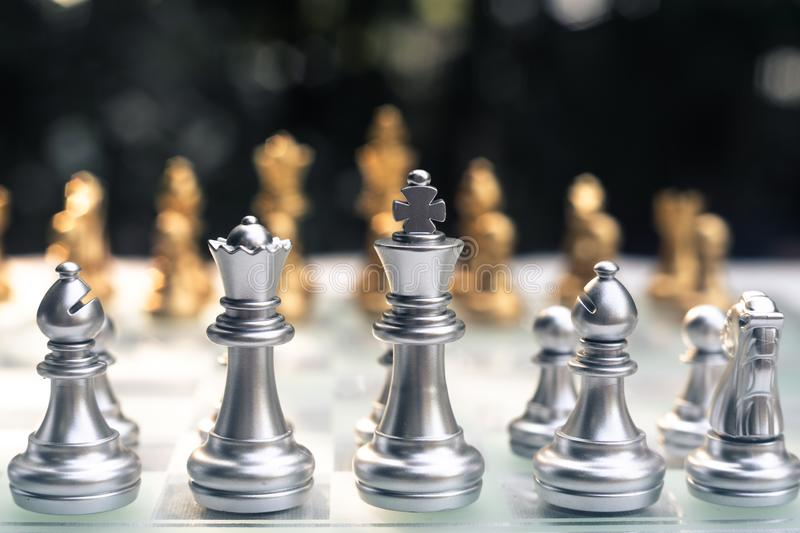 Chess game. Two team stand against each other. Focus on the nearest team. Business competitive concept. Achievement adrenaline ahead ambition brave challenge stock image