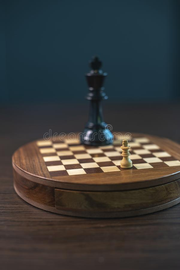 Chess game with white and black, little and giant. stock photo
