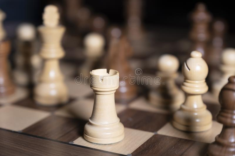 Chess game. White and black pieces are fighting for victory. The Central figure is in focus. The concept of teamwork stock images
