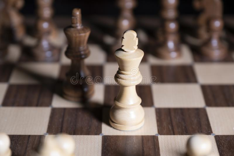 Chess game. White and black pieces are fighting for victory. The Central figure is in focus. The concept of teamwork stock photo