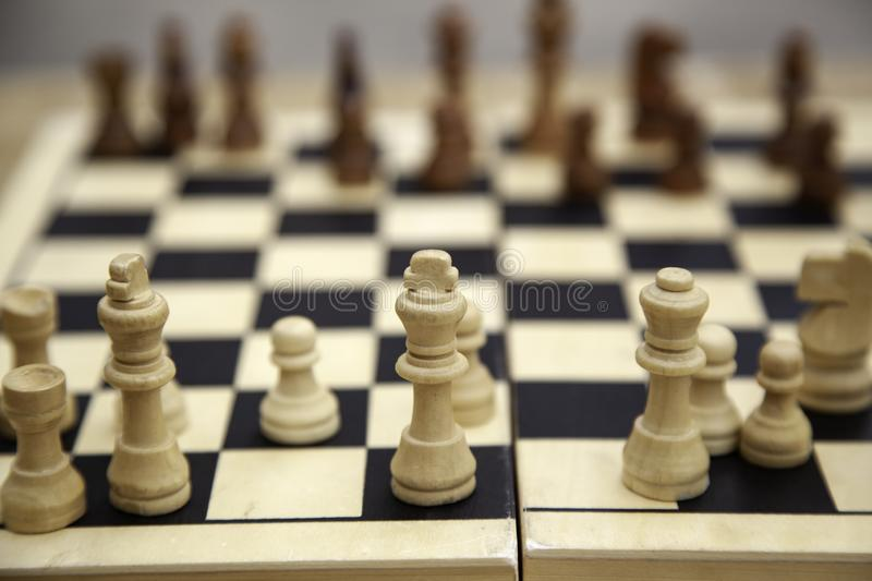 Chess game. Wooden board, hobbies and intelligence, background, king, success, strategy, chessboard, pawn, concept, play, competition, challenge, business stock photography