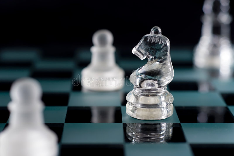 Chess Horse. A shot of a chessboard with focus on the horse stock image