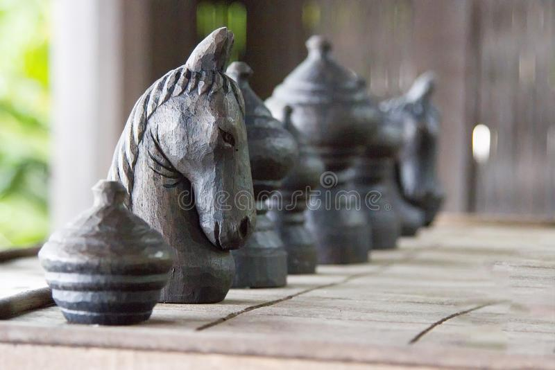 Chess horse made of black wood on board.  stock photography