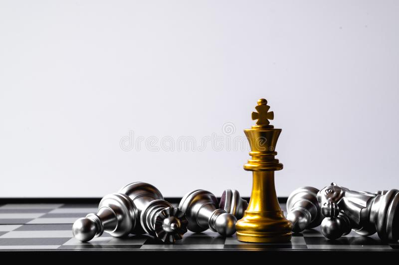 A chess king last stand as a true winner.Money game concept. Copy space. Play, playing, finance, business, economy, competition, strategy, economic, investment royalty free stock images