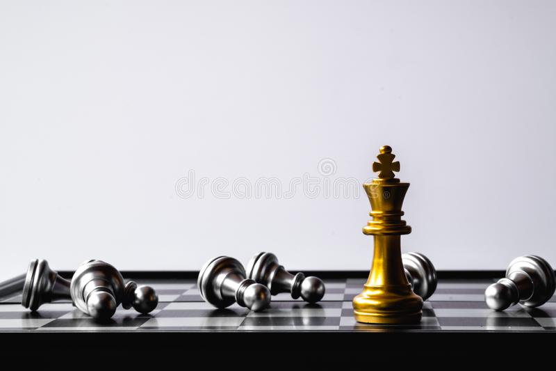 A chess king last stand as a true winner.Money game concept. Copy space. Play, playing, finance, business, economy, competition, strategy, economic, investment royalty free stock photos