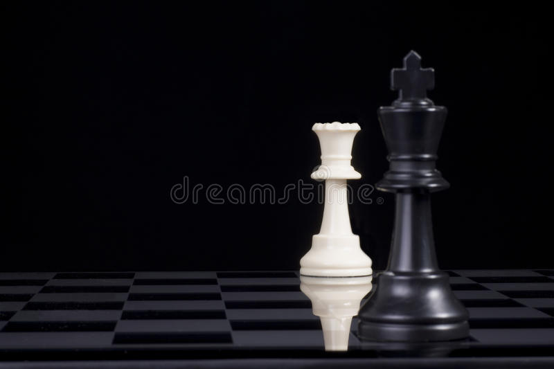 Chess King and Queen Checkmate stock photography