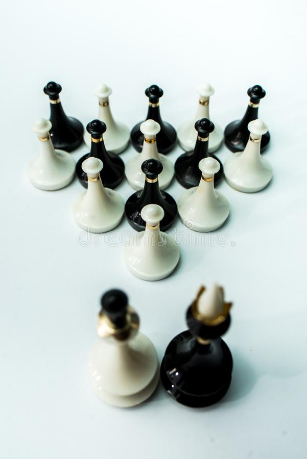 Chess pieces  on chessboard on white background. Chess king and queen on chessboard on black background rules power stock photos
