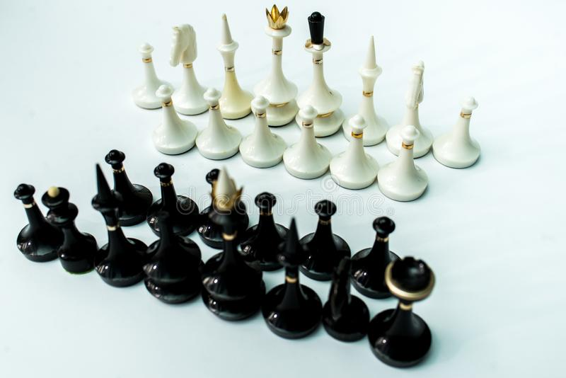 Chess pieces  on chessboard on white background. Chess king and queen on chessboard on black background rules power stock image