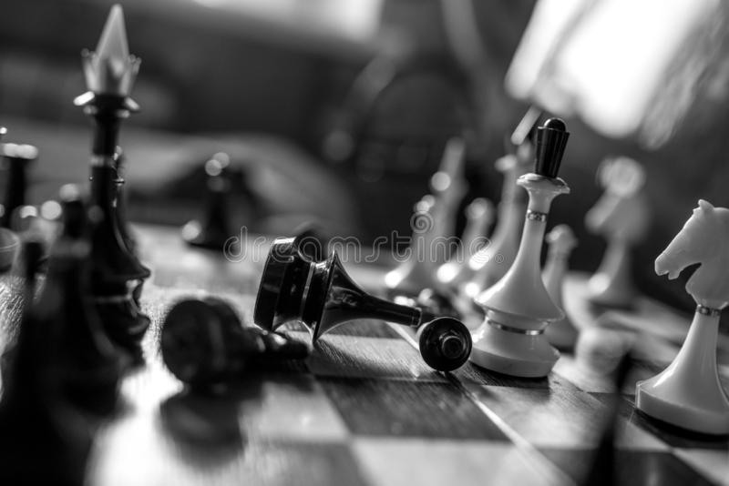 Chess pieces king and queen  on chessboard on white background. Chess king and queen on chessboard on black background rules power stock images