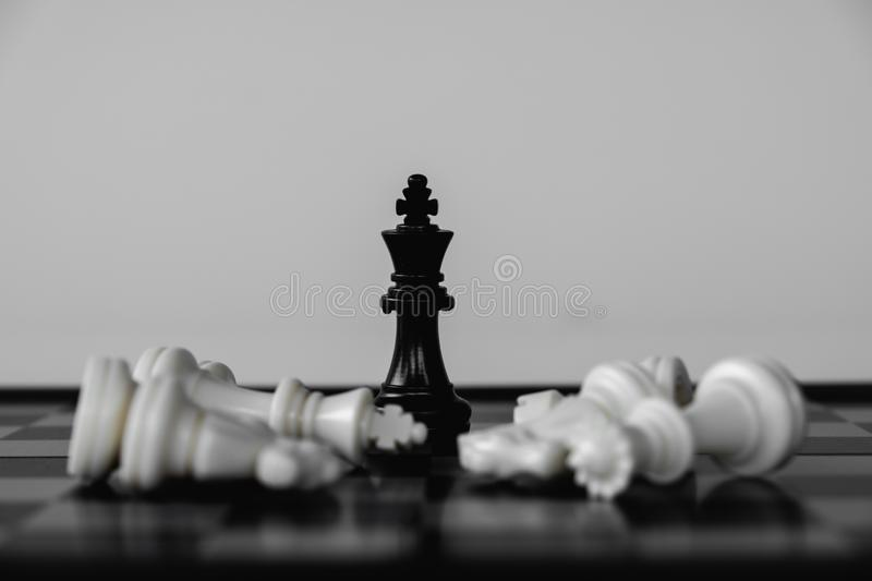 Chess King stand as last winner, victory over the enemies. The winner in business competition. Competitiveness and strategy. Leader, courage, success, brave royalty free stock images