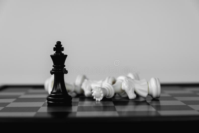 Chess King stand as last winner, victory over the enemies. The winner in business competition. Competitiveness and strategy. Leader, courage, success, brave royalty free stock photo