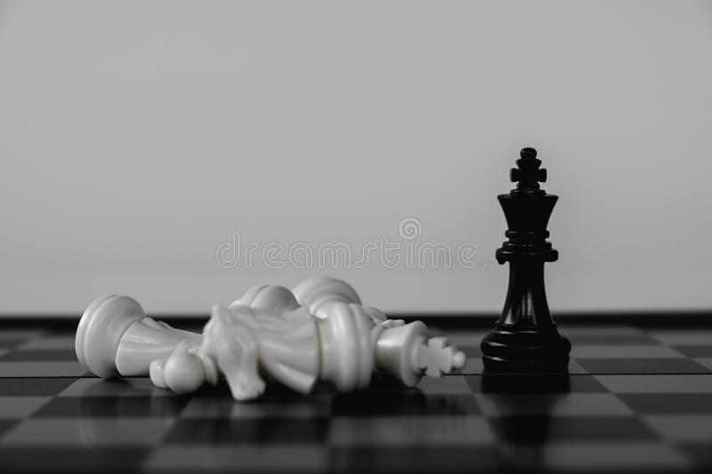Chess King stand as last winner, victory over the enemies. The winner in business competition. Competitiveness and strategy. Leader, courage, success, brave stock photography