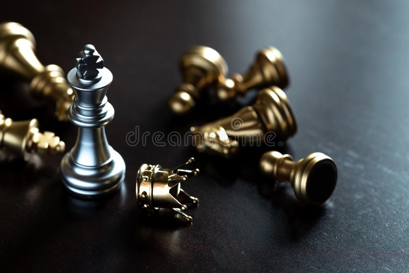 Chess King stand over the enemies. The winner in business competition. Competitiveness and strategy. Copy space leader courage success brave hero power strong royalty free stock photos