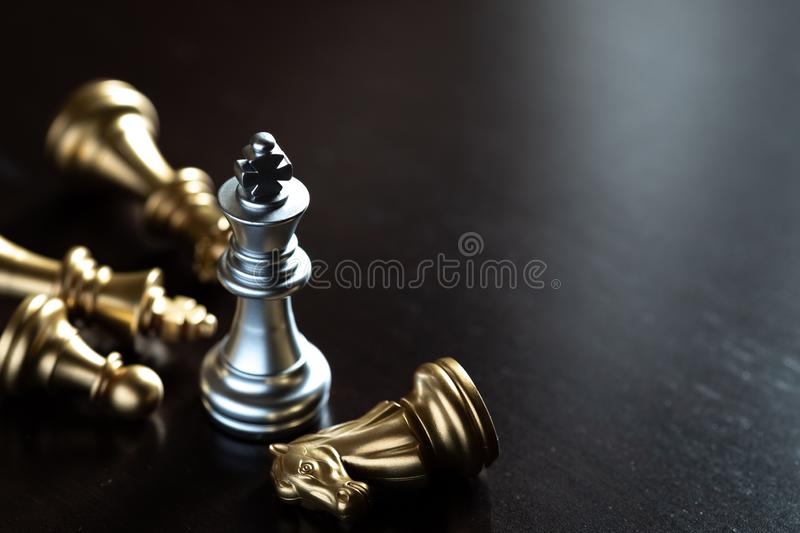 Chess King stand over the enemies. The winner in business competition. Competitiveness and strategy. Copy space, leader, courage, success, brave, hero, power stock photos