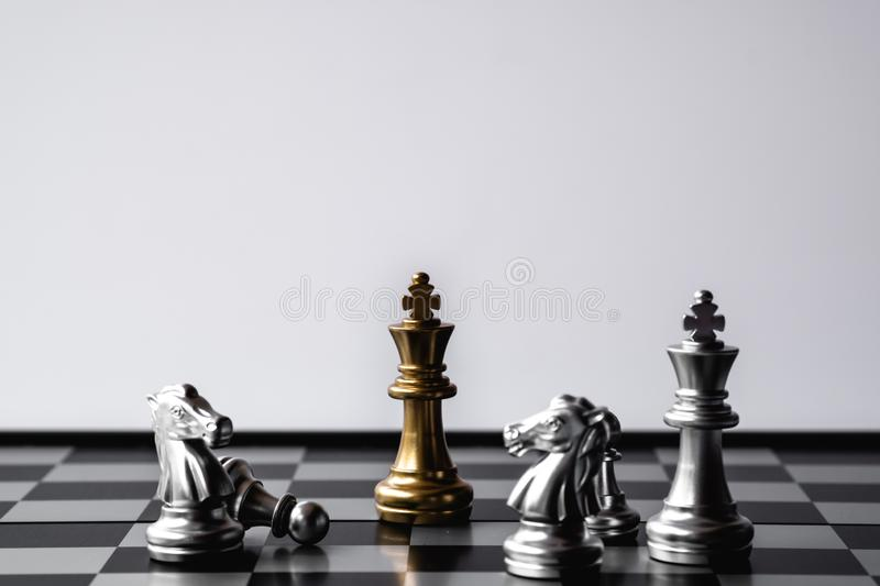 Chess King stand over the enemies. The winner in business competition. Competitiveness and strategy. Copy space. Leader, courage, success, brave, hero, power royalty free stock photography