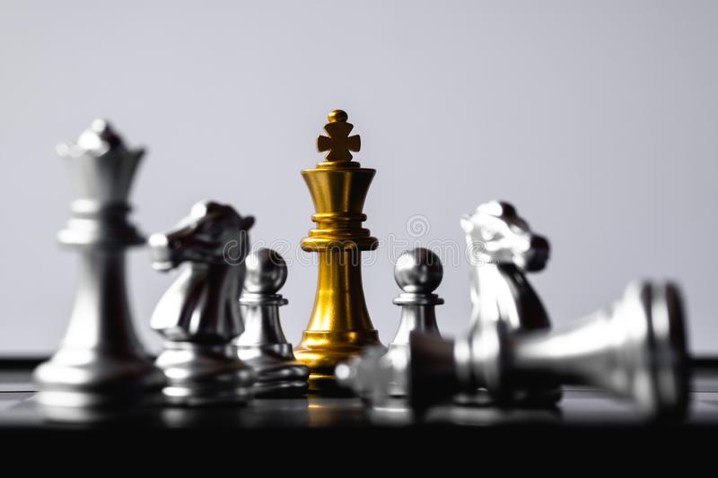Chess King stand over the enemies. The winner in business competition. Competitiveness and strategy. Copy space. Leader, courage, success, brave, hero, power royalty free stock photos