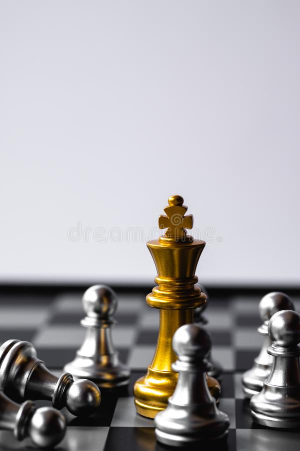 Chess King stand over the enemies. The winner in business competition. Competitiveness and strategy. Copy space. Leader, courage, success, brave, hero, power stock photography