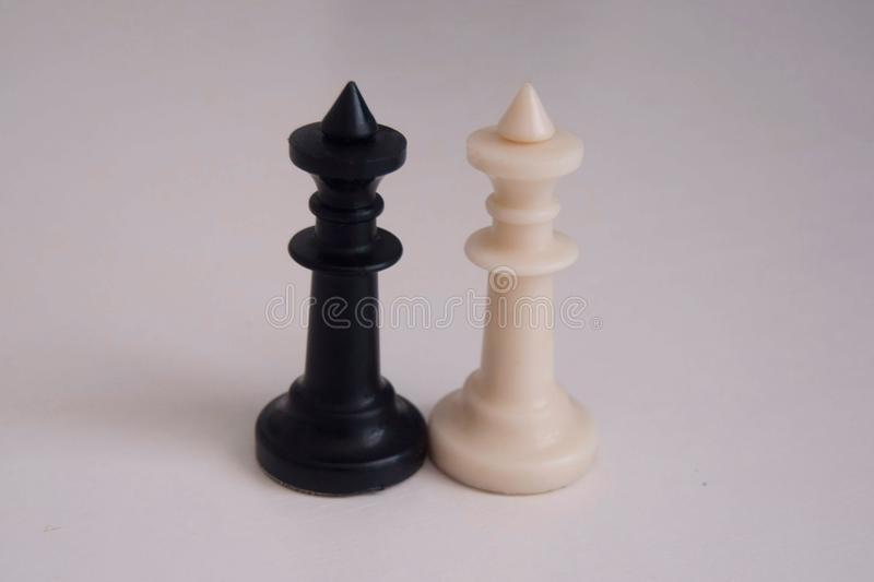 Chess kings. Black and white figures royalty free stock images