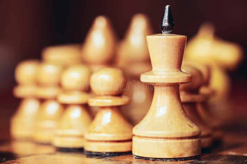 Chess leader. Led king his army white wooden figures. Concept game stock photo