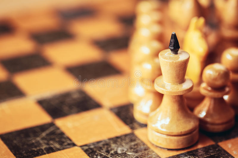 Chess leader. Led king his army white wooden figures. Concept game background. Close up focus stock images