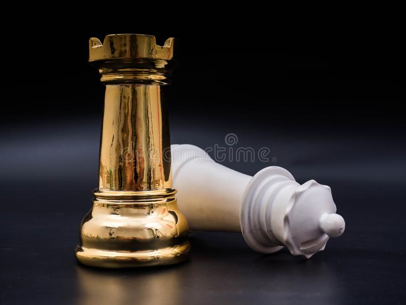 Chess leadership concept with gold and white chess isolated in black background. Chess concept save the strategy stock images