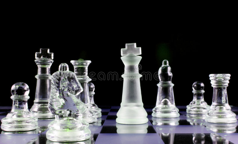 Chess - Never give up. Glass Chess Pieces on a Frosted Glass Chess Board stock images