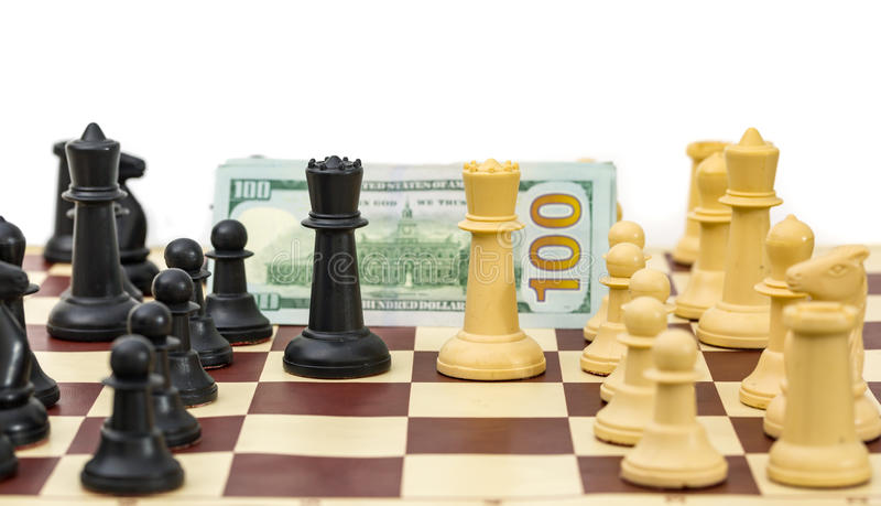 Chess opponents for money. Chess pieces opponents for money royalty free stock image