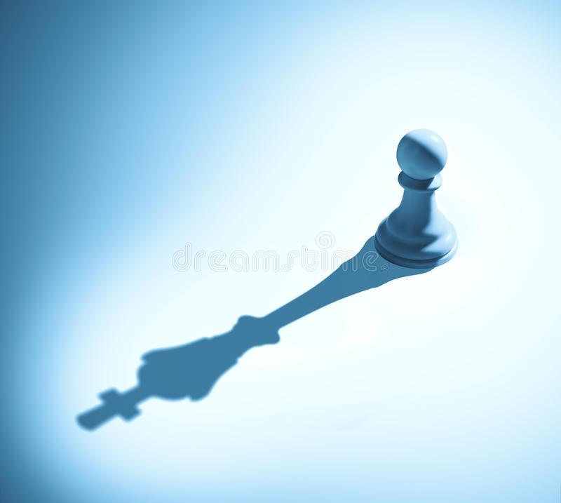 Chess pawn casting a king piece shadow stock photo