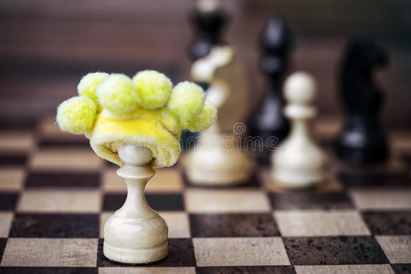 Chess pawn in foolish hat royalty free stock image