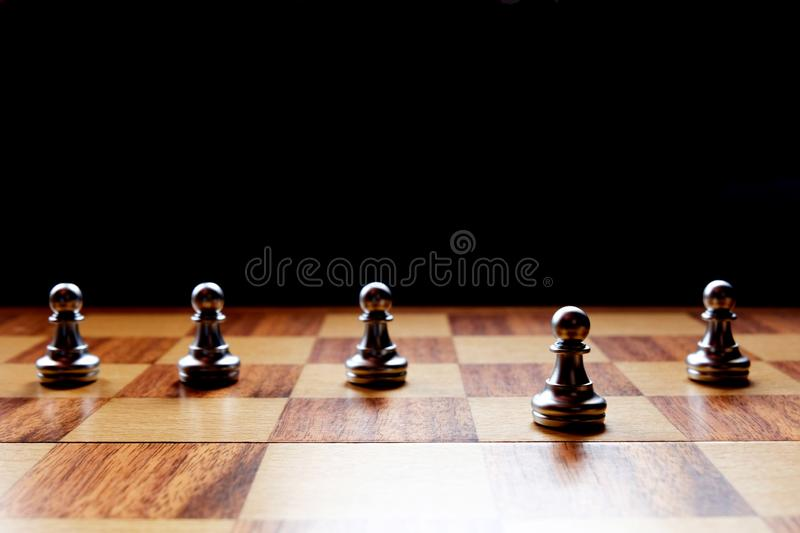 A chess pawn stand out from the others. Business leadership concept. Copy space stock photo