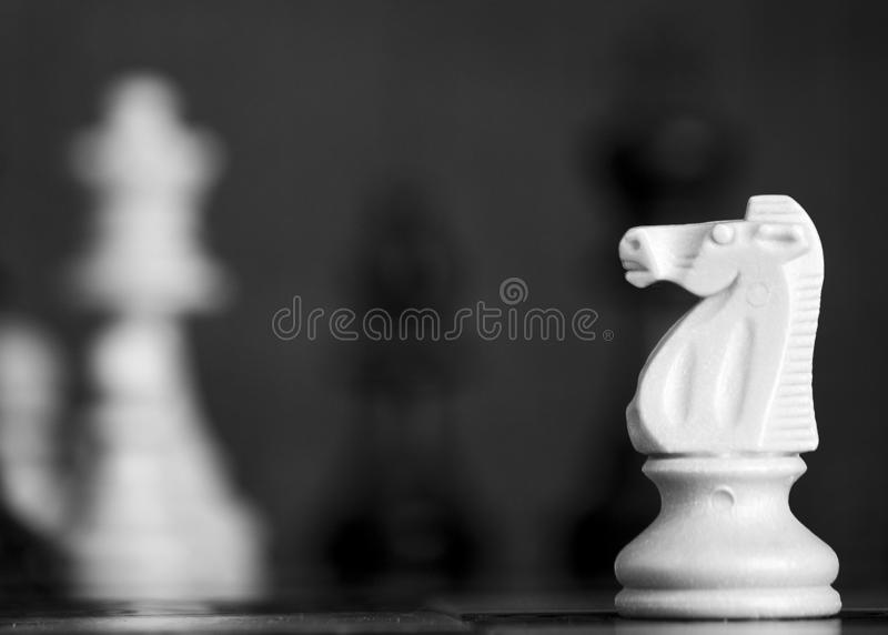 Chess photographed on a chessboard stock images