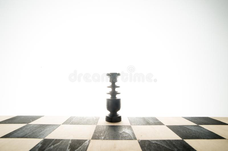 A chess piece, bishop. On the chess board stock image