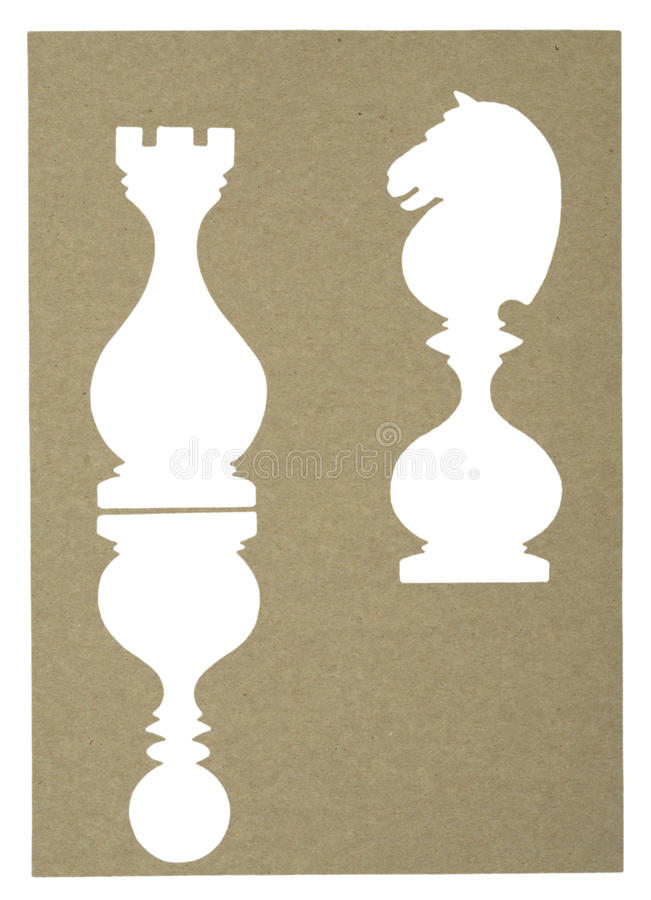 Chess piece cut from an old paper. Isolated on a vintage old paper background royalty free stock photos