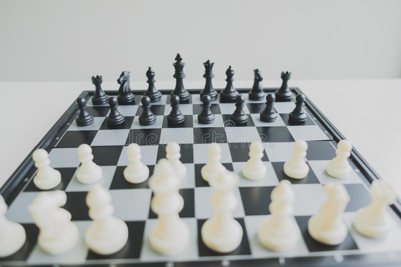 Chess pieces on board with white background, driven to success Business Strategy.  stock image