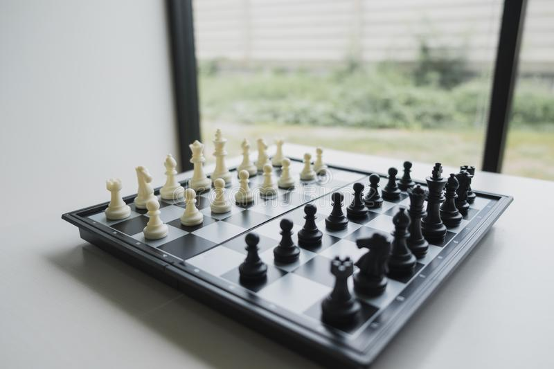 Chess pieces on board with white background, driven to success Business Strategy.  stock photo