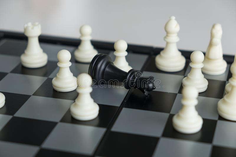 Chess pieces on board with white background, driven to success Business Strategy.  stock photos